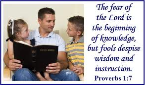 father instructing children