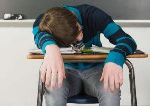kid asleep desk